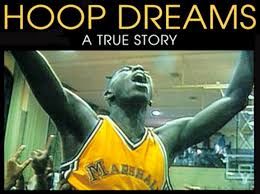 The DVD cover of 'Hoop Dreams' is shown with a basketball player in a yellow top raises his arms aloft in celebration and ecstasy.