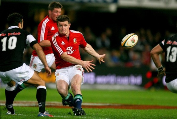 A young Brian O'Driscoll offloads while playing for the British and Irish Lions