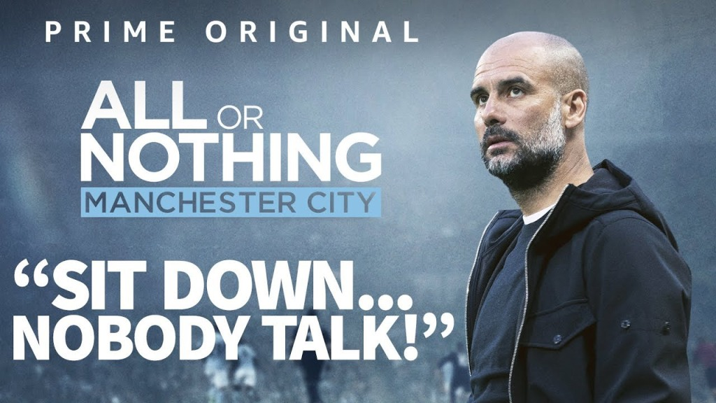 "A poster advertising the Prime Original show 'All or Nothing Manchester City' shows Pep Guardiola looking towards the heavens with the quote from one of his half time team talks ""Sit down... Nobody Talk!"" is written out in block capitals."