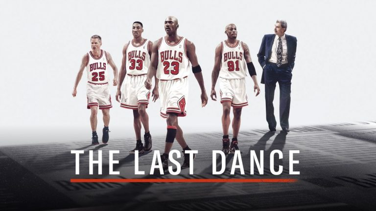 In this promotional poster for the 'The Last Dance', Jordan (centre), Pippen (left) and Rodman are seen walking  in their kits with Steve Kerr (far left) and a suited Phil Jackson (far right)